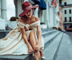 Elegant woman tying shoelaces Stock Photo