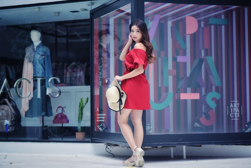 Girl posing in the commercial street Stock Photo
