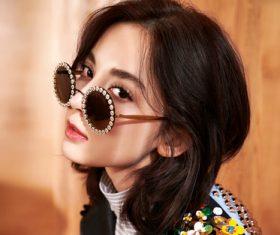 Girl wearing fashionable black sunglasses Stock Photo