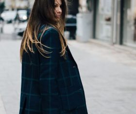 Long-haired woman with bag on the street Stock Photo