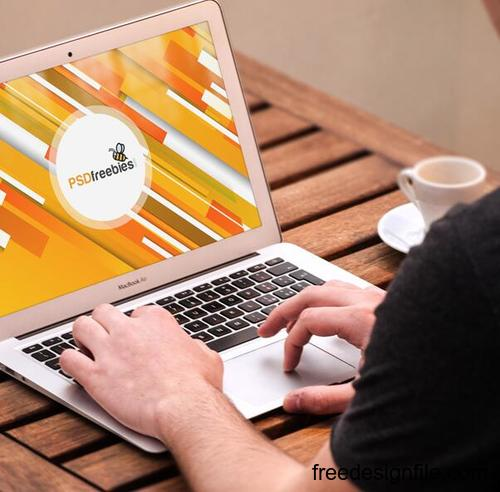 Macbook Pro on Wooden Table Mockup Free PSD 02