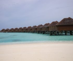 Maldives seaside thatched cottage Stock Photo