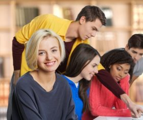 Male and female students in school classroom Stock Photo