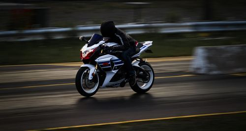 Motorcyclist galloping on the road Stock Photo