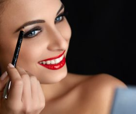 Paint the brows woman Stock Photo