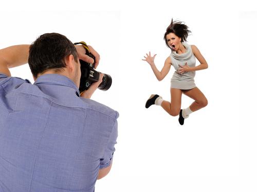 Photographer shooting jumping woman Stock Photo