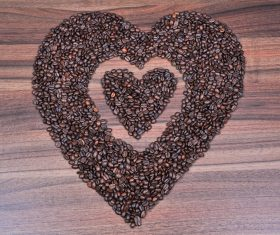 Placing coffee beans heart-shaped pattern Stock Photo