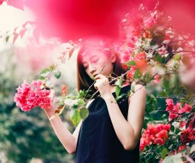 Sleeveless Beauty with flowering branch Stock Photo
