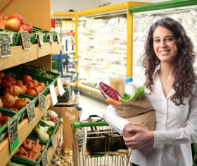 Stock Photo Supermarket shopping woman