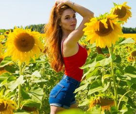 Stock Photo Woman posing in sunflower field