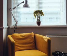 Stock Photo Yellow sofa placed by the window