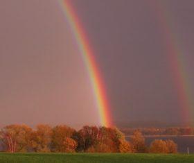 Two rainbows on the horizon Stock Photo