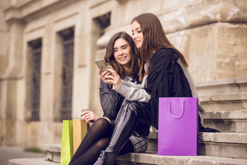 Two shopping beauty sitting on the steps Stock Photo