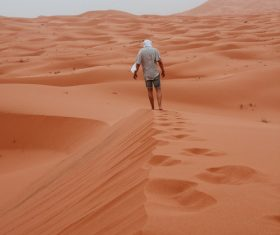Walking alone in the desert Stock Photo