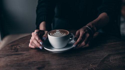 Woman drinking latte Stock Photo