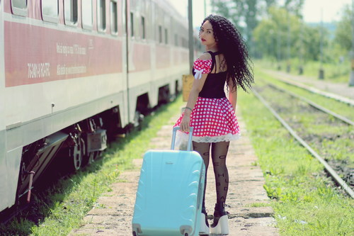 Woman pulling suitcase to travel Stock Photo