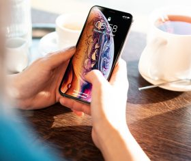 Apple iPhone XS in woman hands Stock Photo
