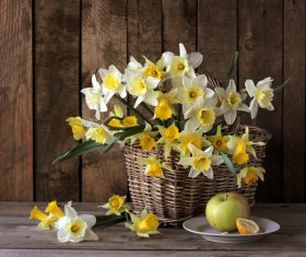 Apple with yellow and white flowers in basket Stock Photo