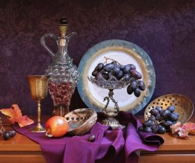 Apples and grapes on purple cloth Stock Photo