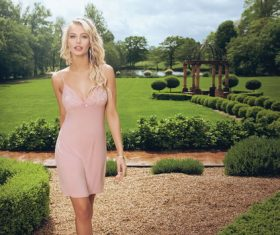 Beautiful charming woman in the garden Stock Photo