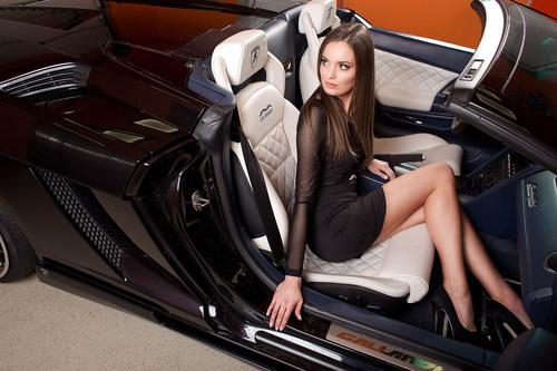 Beautiful female car model in a luxury car Stock Photo