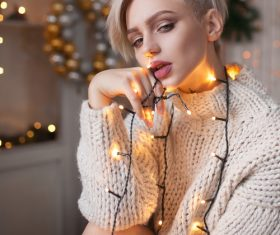 Beautiful girl around the Christmas lights Stock Photo