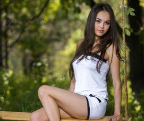 Beautiful girl on a swing Stock Photo