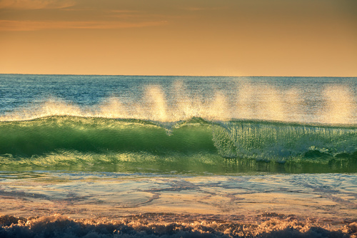 Big waves rolling up on the sea Stock Photo