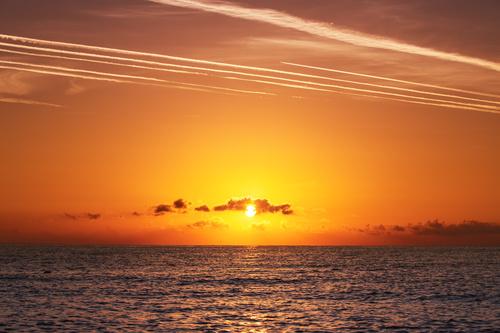 Calm sea under the setting sun Stock Photo