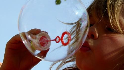 Children blowing bubbles Stock Photo 01