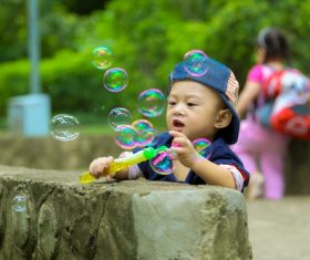 Children blowing bubbles Stock Photo 02
