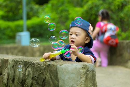 Children blowing bubbles Stock Photo 02