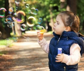 Children blowing bubbles Stock Photo 03