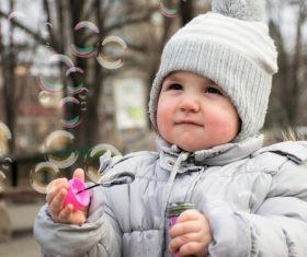 Children blowing bubbles Stock Photo 04