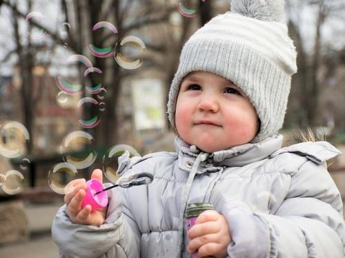 Children blowing bubbles Stock Photo 04