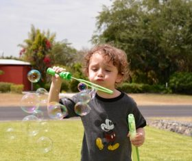 Children blowing bubbles Stock Photo 06