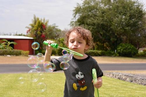 Children blowing bubbles Stock Photo 06