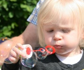 Children blowing bubbles Stock Photo 08