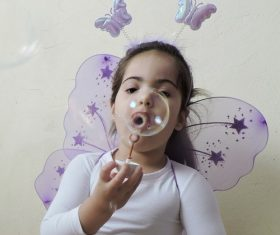 Children blowing bubbles Stock Photo 09