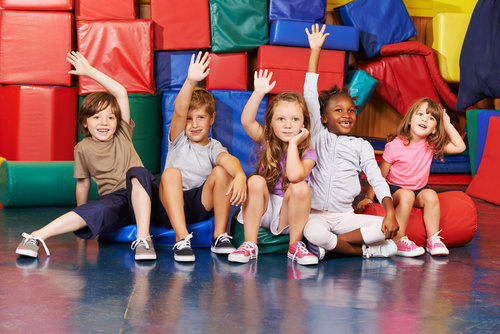 Children raising their hands to answer questions Stock Photo
