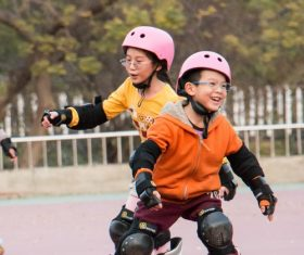 Children rollerblading Stock Photo