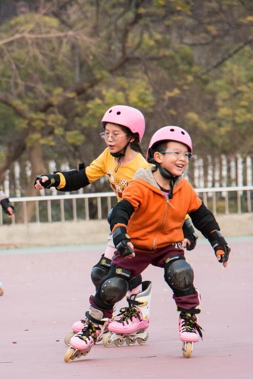 Children rollerblading Stock Photo