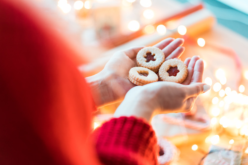 Christmas Cookies in Woman Hands Stock Photo
