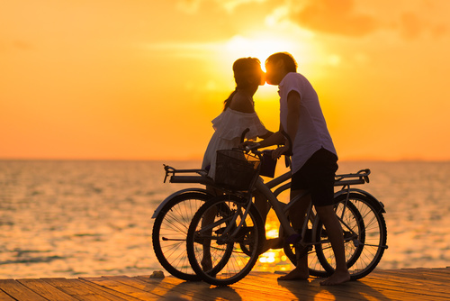 Couple kissing in the morning sun Stock Photo