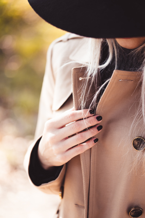 Fashion Woman in Trench Coat Stock Photo