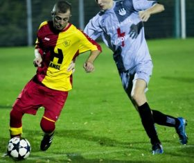 Fast-paced soccer game Stock Photo 07