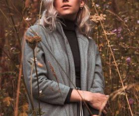 Female model taking photo shoot in autumn outdoors Stock Photo