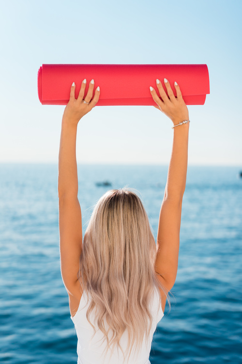 Fitness Girl with Yoga Pilates Mat Stock Photo