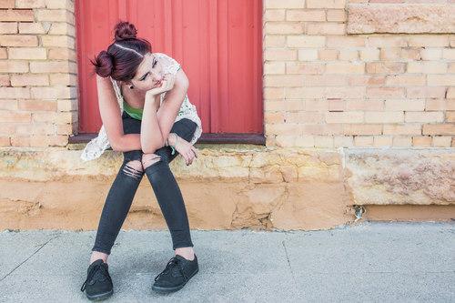 Girl Waiting on Step Stock Photo