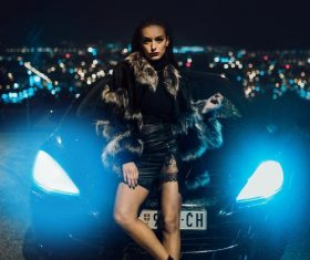 Girl and sports car under the night Stock Photo